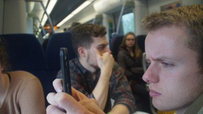 On the train to Dover, Brandon Sebey '17, History and Social Studies Ed major, does reconnaissance to create a plan of attack.