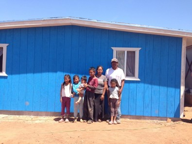 The 2014 family with their new house
