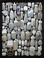 white plastic bottles on a black background