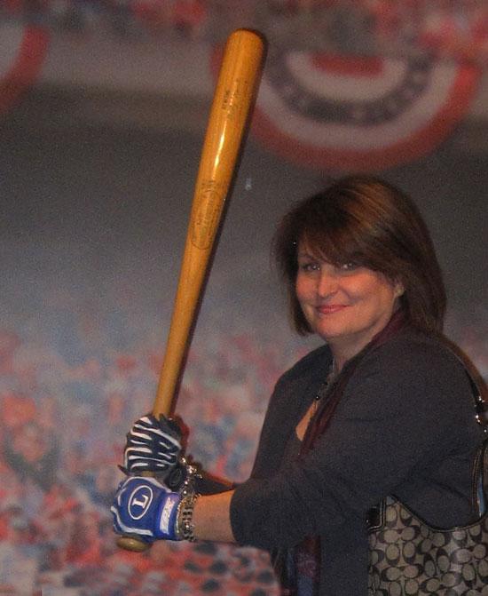 Holding Mickey Mantle's bat