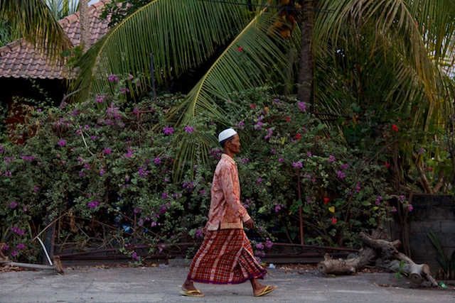 Bali traditional man walking Oct 2015