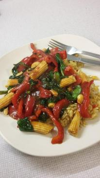 Red pepper, baby corn, spinach and cashew nut stir fry with vegetable rice