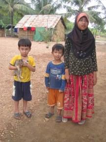 Muslim family with kitten.