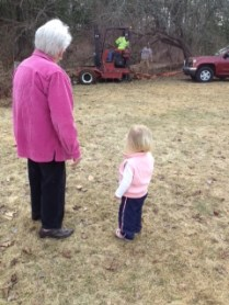 Watching the trucks get stuck in the mud with Great Memere