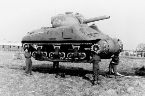 Men lifting tanks