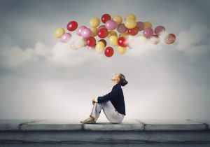 woman with balloons overhead