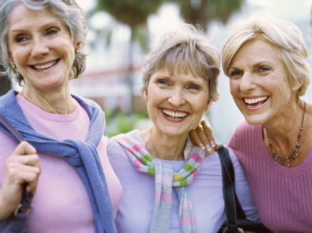 Portrait of three mature women smiling