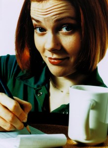 Close-Up of a Waitress Writing on an Order Pad