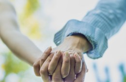 Close up on couple holding hands