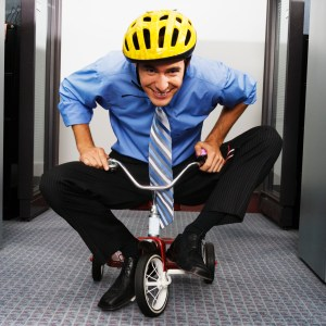 Young Businessman Riding Tricycle