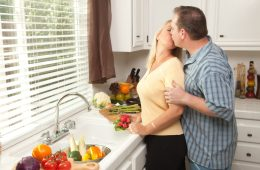 stealing a kiss in kitchen