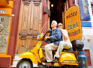 Couple riding scooter in Buenos Aires