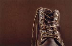 An old leather shoes and brown lace