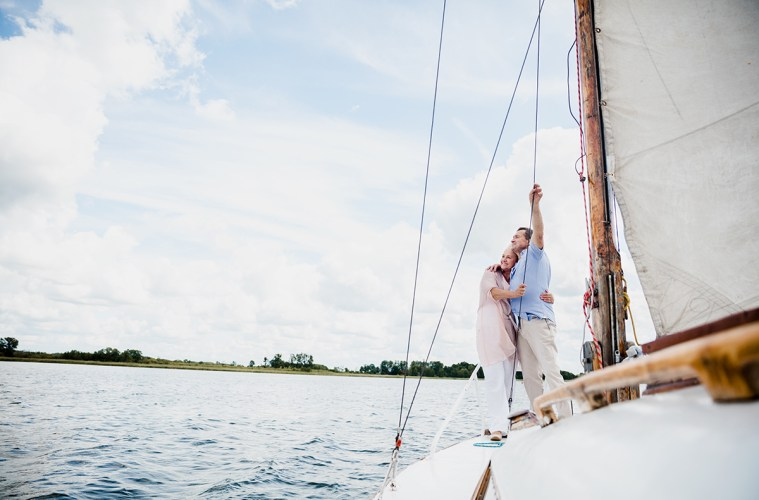 Retired couple sailing on boat