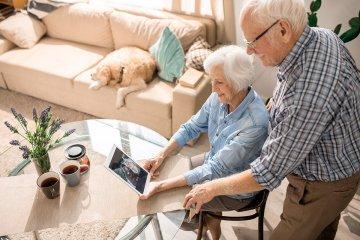 Parents talking on iPad