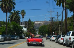 red car driving in hollywood