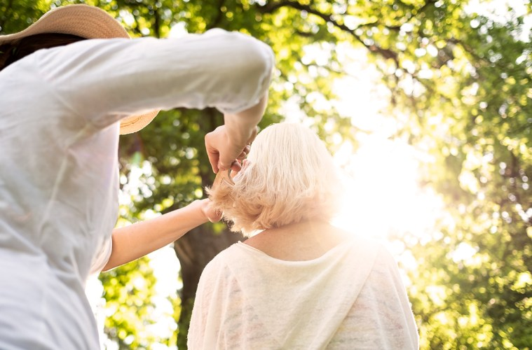 Woman doing an haircut to her grandmother