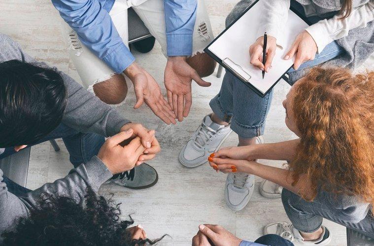 Group of people at drug rehab meeting