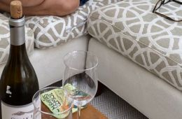 Woman on couch with wine