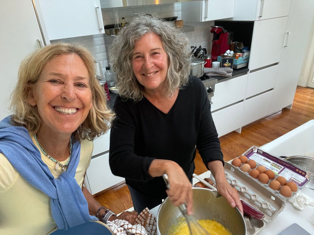 Felice Shapiro and friend cooking eggs
