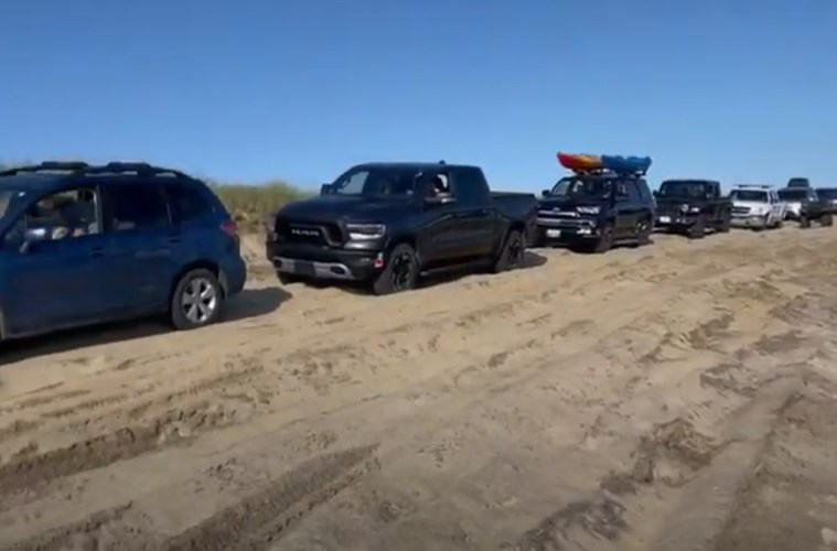 beach with tire tracks