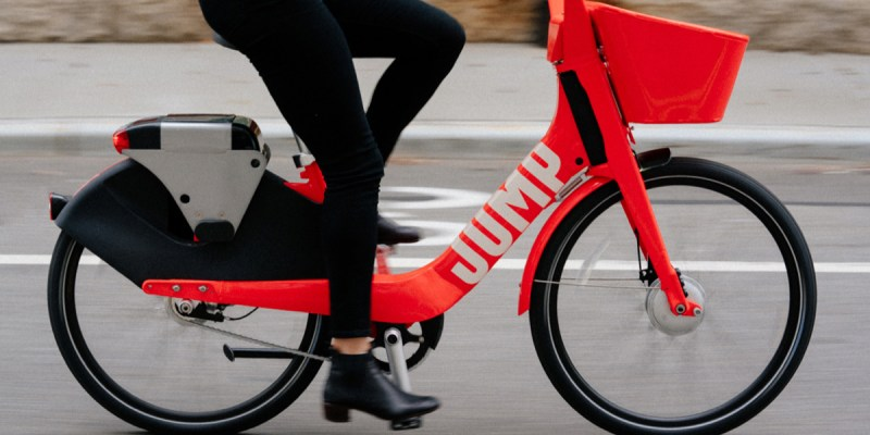 Side view of Uber JUMP ebike being riden on the street
