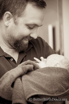 father first time holding baby