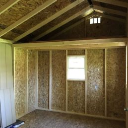 10x16x10 7'sidewalls Barn House with 4x16 porch incorporated into the rafters Inside