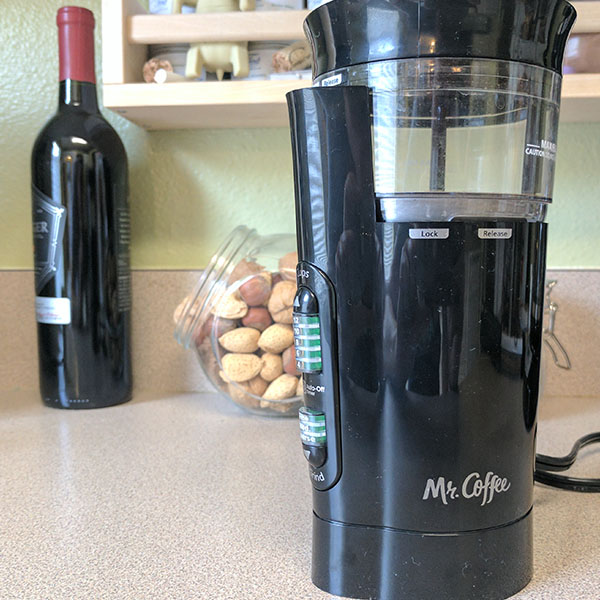 A bad cheap coffee grinder that uses blades to break the beans.