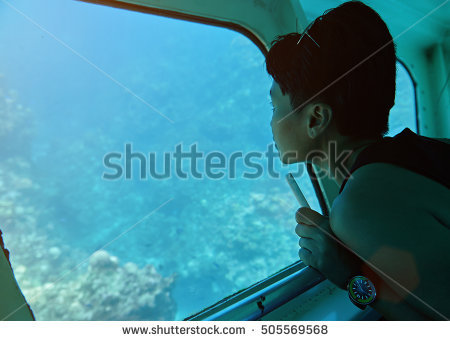 stock-photo-woman-sit-in-glass-bottom-boat-next-to-window-505569568