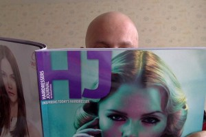 George's bald head reading HJ