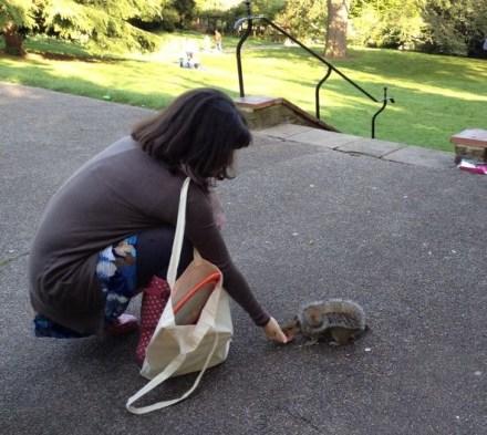 Mariacristina feeding a squirrel