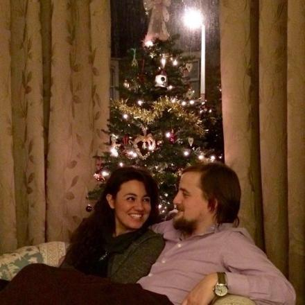 George and Mariacristina in front of a Christmas tree