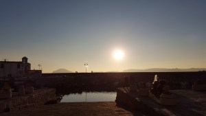 The sun over the sea and the bay of Pozzuoli