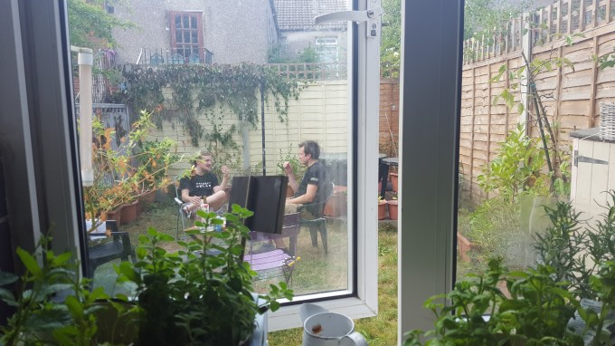 Tim and George chatting in the garden
