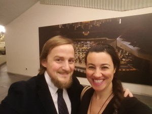 George and Mariacristina looking smart in front of a picture of the Berlin Philharmonic Orchestra