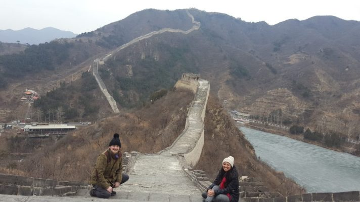 George and Mariacristina on the Great Wall of China, with it snaking away over the mountain in the background