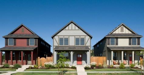 row of 3 single family 2 story homes