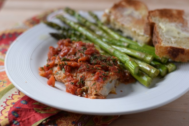 Easy baked fish with canned tomatoes is perfect when you don't want to cook.
