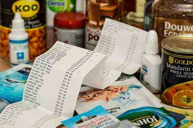 Receipt and variety of foods from grocery store.