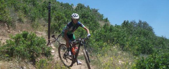 Student Jen Hanks working on mountain bike switchback