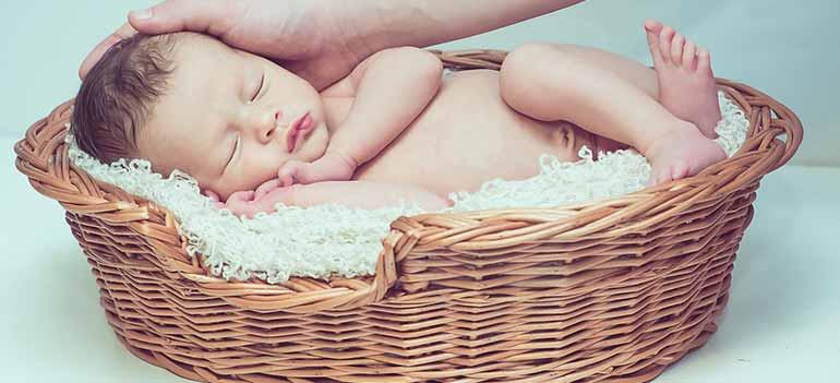 baby sleeping on sleeper