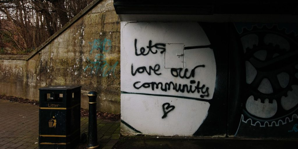 "underpass sign that says ""Let's Love Our Community"""