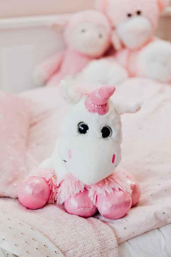 white and pink unicorn plush toy