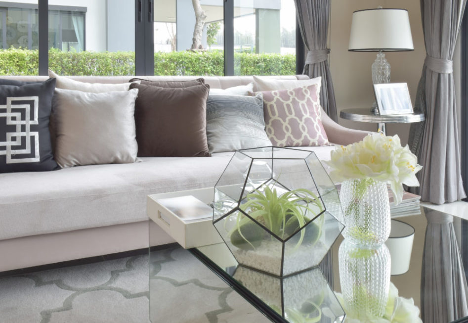 luxury earth tone color pillows on sofa in living room