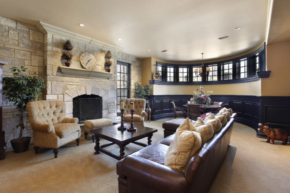 Beautiful finished basement in a luxury home with a stone fireplace