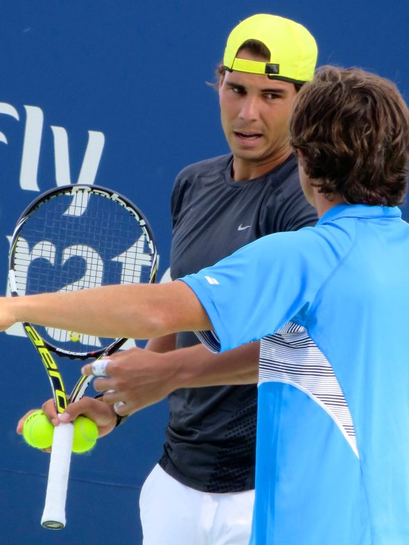 Nadal getting coached.