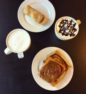 A tea latte and a maple cinnamon bun from Whitehouse Bakery, Wasagaming