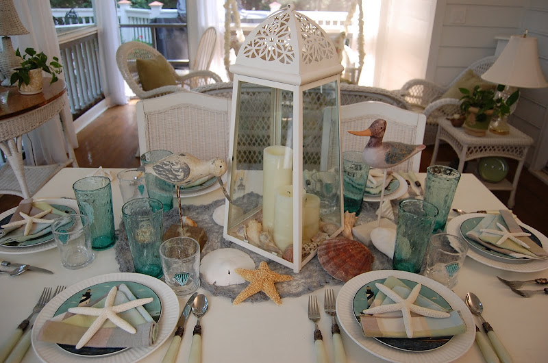 Beach Themed Table Setting With Sailboat Napkin Fold And