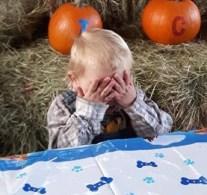 boy hides face
